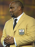 Canton, Ohio - August 1, 2014: Former NFL tackle Walter Jones accepts his gold jacket during the Pro Football Hall of Fame's class of 2014 enshrinement dinner in Canton, Ohio  August 1, 2014. Jones was named to nine Pro Bowls during his career.  (Photo by Don Baxter/Media Images International)