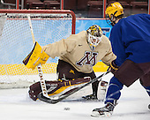 Connor Reilly (MN - 21), Ryan Coyne (MN - 31) - The University of Minnesota Golden Gophers practiced on Wednesday, April 9, 2014, at the Wells Fargo Center in Philadelphia, Pennsylvania during the 2014 Frozen Four.