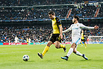 Borussia Dortmund Defender Sokratis Papastathopoulos (L) in action against Marco Asensio of Real Madrid (R) during the Europe Champions League 2017-18 match between Real Madrid and Borussia Dortmund at Santiago Bernabeu Stadium on 06 December 2017 in Madrid Spain. Photo by Diego Gonzalez / Power Sport Images