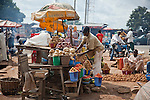 A boy mans a fruit and vegetable table at a roadside market in Nigeria's Niger State.