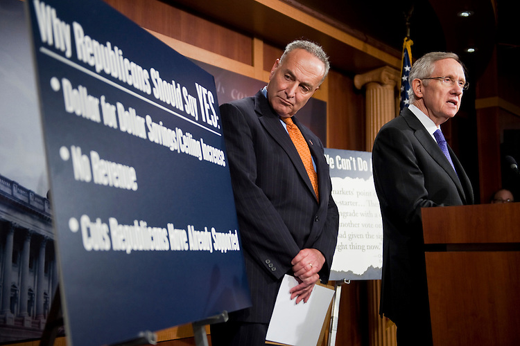 UNITED STATES - JULY 25:  Senate Majority Leader Harry Reid, D-Nev., right, and Sen. Charles Schumer, D-N.Y., conduct a news conference in the Capitol on a new proposal to deal with the raising of the debt ceiling.  (Photo By Tom Williams/Roll Call)