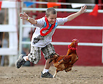Joseph Brandt competes in the chicken race at the International Camel Races in Virginia City, Nev., on Friday, Sept. 9, 2011. .Photo by Cathleen Allison