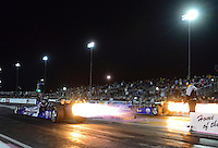 Oct. 26, 2012; Las Vegas, NV, USA: NHRA jet dragsters light up the night sky during qualifying for the Big O Tires Nationals at The Strip in Las Vegas. Mandatory Credit: Mark J. Rebilas-