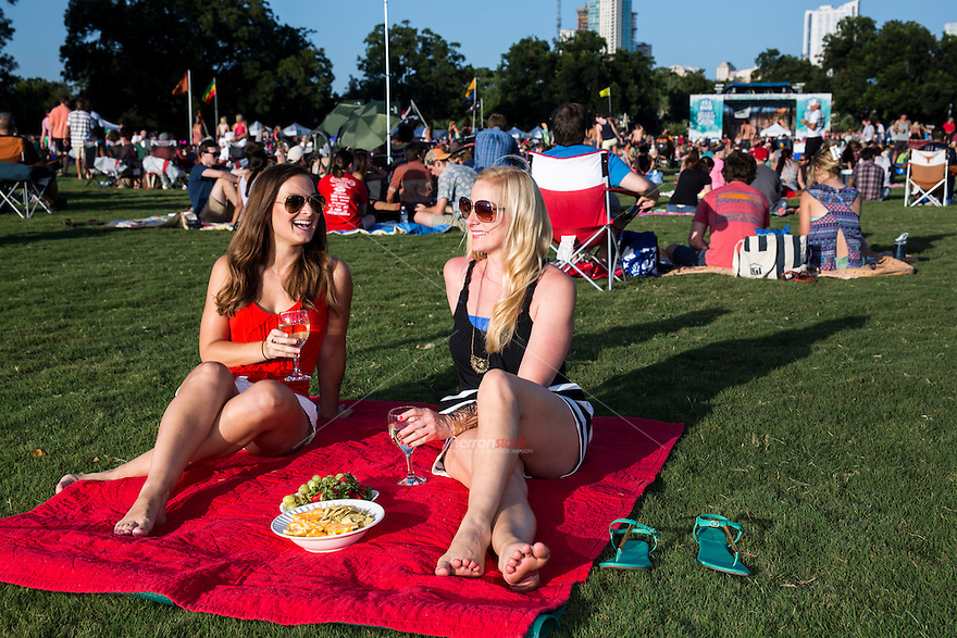 Thousands of Austinites come to Zilker Park every Wednesday during the summer to enjoy a picnic at the Blues On The Green free summertime concert series in Zilker Park, Austin, Texas.