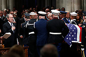 Former President George W. Bush places his hand over his heart  as the flag-draped casket of former President George H.W. Bush is carried by a joint services military honor guard after the State Funeral at the National Cathedral, Wednesday, Dec. 5, 2018, in Washington. <br /> Credit: Alex Brandon / Pool via CNP
