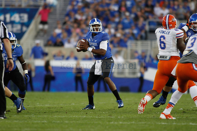 Kentucky Wildcats quarterback Jalen Whitlow (2) prepares to throw the ball during the first half of the UK football game against Florida at Commonwealth Stadium in Lexington, Ky., on Saturday, September 28, 2013. Photo by Eleanor Hasken | Staff