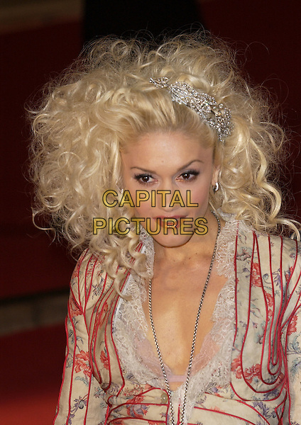 GWEN STEFANI.Brit Awards 2005.Earls Court 2, London, SW5.February 10th, 2005.headshot portrait stripes hair clip accessory ringlets curly hair lace bra.www.capitalpictures.com.sales@capitalpictures.com.©Capital Pictures