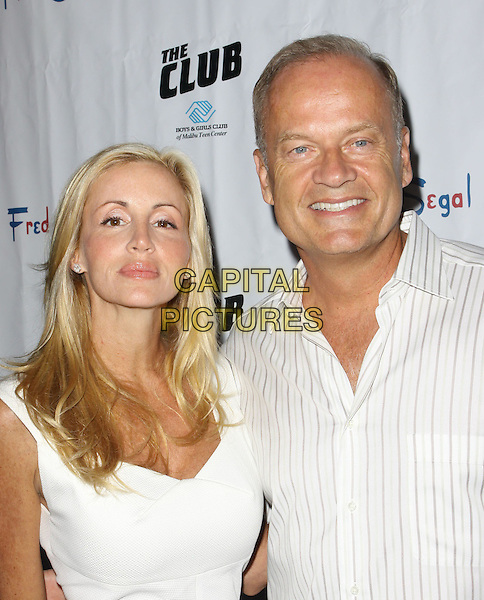 CAMILLE DONATACCI & KELSEY GRAMMER.Fred Segal Celebrates His Birthday held A Private Residencel, Malibu, California, USA..August 29th, 2009.half length white dress shirt striped stripes married husband wife .CAP/ADM/KB.©Kevan Brooks/AdMedia/Capital Pictures.