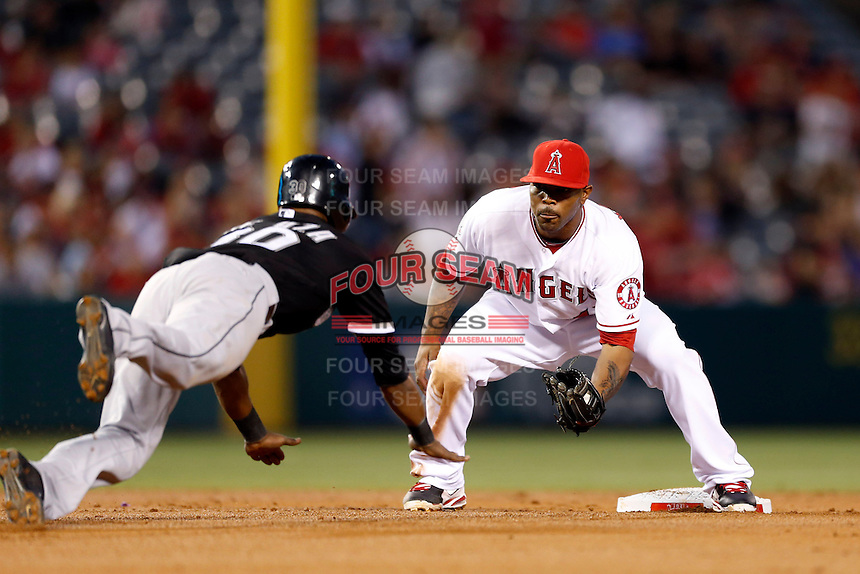 Howie Kendrick #47 of the Los Angeles Angels prepares to tag out Alejandro De Aza #30 of the Chicago White Sox at second base at Angel Stadium on May 17, 2013 in Anaheim, California. (Larry Goren/Four Seam Images)