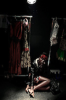 CAPE TOWN, SOUTH AFRICA - AUGUST 13: Nigerian model Bumni Ademokoya waits backstage to be dressed before a show with Stoned Cherrie, a fashion label, at the African Fashion International Cape Town fashion week on August 13, 2010, at the Cape Town International Convention Center, in Cape Town, South Africa. Stoned Cherrie is founded by Nkhensani Nkosi, age 37, a mother of four and a celebrated fashion designer, entrepreneur, television personality and an actress in South Africa. She launched her new collection Love Movement at this event. (Photo by Per-Anders Pettersson/