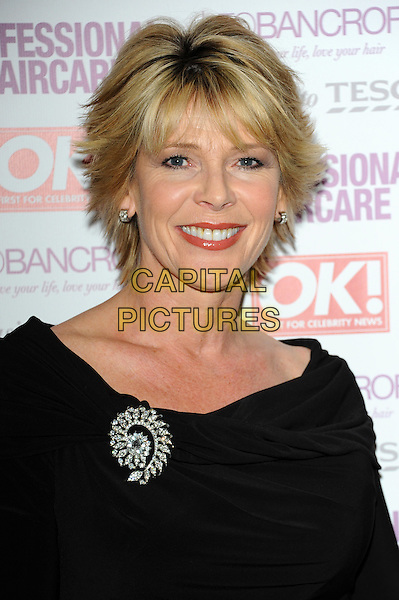 Ruth Langsford.Leo Bancroft range - launch party.celebrity hairstylist launches his latest brand of products at exclusive West End members club, The Club at The Ivy, London, England..April 18th, 2012.headshot portrait black silver brooch.CAP/CJ.©Chris Joseph/Capital Pictures.