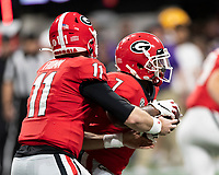 ATLANTA, GA - DECEMBER 7: Jake Fromm #11 of the Georgia Bulldogs hand the ball off to D'Andre Swift #7 during a game between Georgia Bulldogs and LSU Tigers at Mercedes Benz Stadium on December 7, 2019 in Atlanta, Georgia.