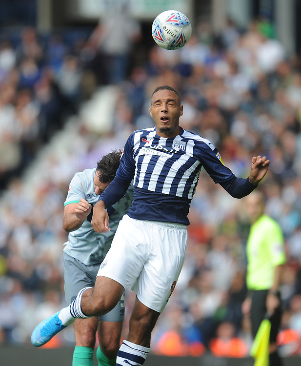 West Bromwich Albion's Kenneth Zohore vies for possession with Blackburn Rovers' Greg Cunningham<br /> <br /> Photographer Kevin Barnes/CameraSport<br /> <br /> The EFL Sky Bet Championship - West Bromwich Albion v Blackburn Rovers - Saturday 31st August 2019 - The Hawthorns - West Bromwich<br /> <br /> World Copyright © 2019 CameraSport. All rights reserved. 43 Linden Ave. Countesthorpe. Leicester. England. LE8 5PG - Tel: +44 (0) 116 277 4147 - admin@camerasport.com - www.camerasport.com