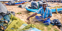 Panoramic photo of a fisherman working in Negombo fish market (Lellama), Sri Lanka, Asia. This is a panoramic photo of a fisherman working in Negombo fish market (Lellama), Sri Lanka, Asia. Negombo fish market, known as Lellama is the second biggest fish market is Sri Lanka.