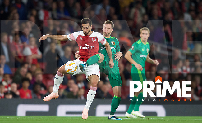 Henrikh Mkhitaryan of Arsenal & Dmytro Kravchenko of Vorskla Poltava during the UEFA Europa League match group between Arsenal and Vorskla Poltava at the Emirates Stadium, London, England on 20 September 2018. Photo by Andrew Aleksiejczuk / PRiME Media Images.