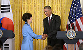 United States President Barack Obama shakes hands with President Park Geun-hye of the Republic of Korea during their joint press conference  in the East Room of the White House October 16 2015 in Washington, DC.<br /> Credit: Olivier Douliery / Pool via CNP