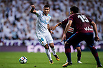 Carlos Henrique Casemiro (l) of Real Madrid fights for the ball with Takashi Inui (c) of SD Eibar during the La Liga 2017-18 match between Real Madrid and SD Eibar at Estadio Santiago Bernabeu on 22 October 2017 in Madrid, Spain. Photo by Diego Gonzalez / Power Sport Images