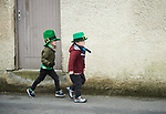 Senan Chaplin and Shay Kearney on their way to start of the St Patrick's Day parade in Sixmilebridge. Photograph by John Kelly.
