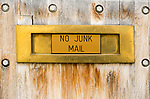 No Junk Mail sign on domestic letter box on housefront door, UK