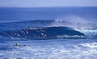 Surfer paddling out in perfect waves, Siargao Island, Philippines