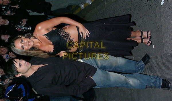 "ANDY SCOTT LEE & MICHELLE HEATON.Special Screening of ""The Grudge"", Covent Garden, London, October 27th 2004..full length tanned skimpy top black skirt midrif tummmy boyfriend girlfriend couple.Ref: CAN.www.capitalpictures.com.sales@capitalpictures.com.©Capital Pictures."