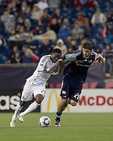 Vancouver Whitecaps FC midfielder Gershon Koffie (28) brings the ball forward as New England Revolution midfielder Stephen McCarthy (26) pressures. In a Major League Soccer (MLS) match, the New England Revolution defeated the Vancouver Whitecaps FC, 1-0, at Gillette Stadium on May14, 2011.