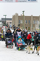 Michelle Phillips and team leave the ceremonial start line with an Iditarider and handler at 4th Avenue and D street in downtown Anchorage, Alaska on Saturday March 7th during the 2020 Iditarod race. Photo copyright by Cathy Hart Photography.com