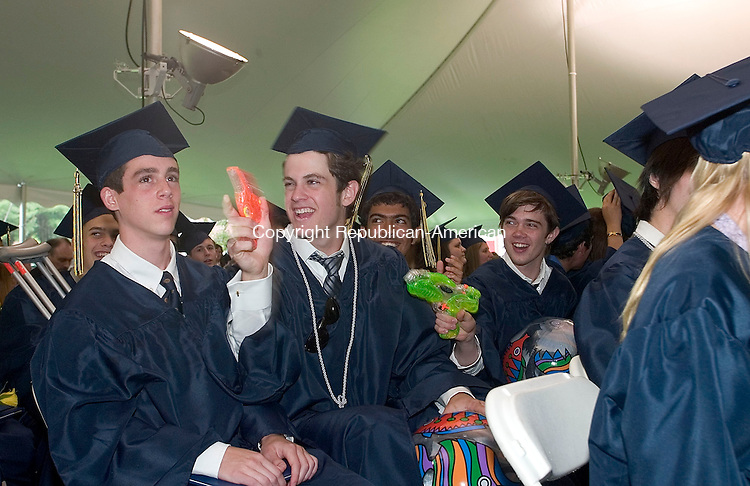 CHESHIRE, CT -31 MAY 2008 -053108DA07- Robert Grillo, second from left, and Sean Gaffney, right, squirt their fellow classmates after receiving their diplomas, as William Gross, left and Rashid Ghobash, second from right look on during the commencement for the Cheshire Academy graduating class of 2008 at the school in Cheshire Saturday.<br /> <br /> Darlene Douty/Republican-American