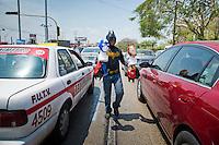 Carlos Daniel, 17 year old super hero mask salsemen working at a traffic light in Merida, Yucatan