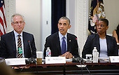 United States President Barack Obama, center, is flanked by W. James McNerney, Jr., Chairman and CEO of The Boeing Company, left, and Ursula M. Burns, Chairman and CEO of Xerox, right, during a meeting of the President's Export Council in the Eisenhower Executive Office Building of the White House,  June 19, 2014 in Washington, DC. The President's Export Council advises the President on policies and programs that affect U.S. trade performance and promote export expansion.<br /> Credit: Olivier Douliery / Pool via CNP