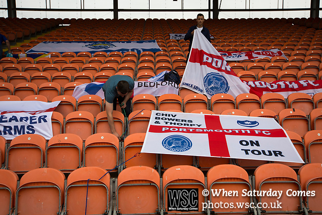 Visiting fans taking down flags at Bloomfield Road stadium as Blackpool after hosted Portsmouth in an English League One fixture. The match was proceeded by a protest by around 500 home fans against the club's controversial owners Owen Oyston, many of whom did not attend the game. The match was won by the visitors by 2-1 with two goals by Ronan Curtis watched by just 4,154 almost half of which were Portsmouth supporters.