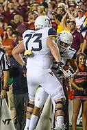 Landover, MD - September 3, 2017: West Virginia Mountaineers offensive lineman Josh Sills (73)  and West Virginia Mountaineers wide receiver David Sills V (13) celebrates after a touchdown during game between Virginia Tech and WVA at  FedEx Field in Landover, MD.  (Photo by Elliott Brown/Media Images International)