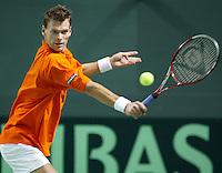 04-03-2006,Swiss,Freibourgh, Davis Cup , Swiss-Netherlands, Sjeng Schalken in actie tegen  Marco Chiudinelli