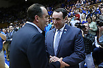 07 February 2015: Duke head coach Mike Krzyzewski (right) and Notre Dame head coach Mike Brey (left) shake hands before the game. The Duke University Blue Devils hosted the University of Notre Dame Fighting Irish at Cameron Indoor Stadium in Durham, North Carolina in a 2014-16 NCAA Men's Basketball Division I game. Duke won the game 90-60.
