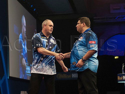 21.12.2014.  London, England.  William Hill PDC World Darts Championship.  John Michael [GRE] congratulates Ian White (15) [ENG] following their match. White won the match 3-1