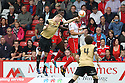 Jon Ashton of Stevenage heads clear from Nathan Clarke of Leyton Orient<br />  - Stevenage v Leyton Orient - Sky Bet League 1 - Lamex Stadium, Stevenage - 17th August, 2013<br />  © Kevin Coleman 2013