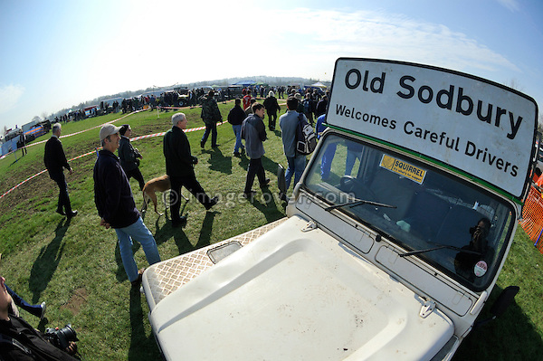Sign on Land Rover reading Old Sodbury Welcomes Careful Drivers. Old Sodbury Land Rover Sortout on April 2 at Newbury Showground UK 2005.  The Old Sodbury Sortout is the biggest autojumble for buying and selling Land Rover parts.