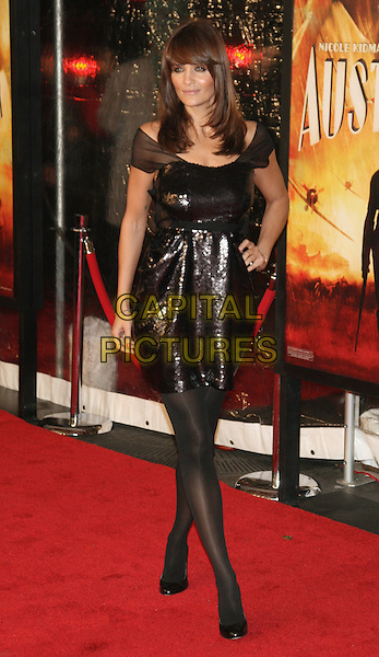 """HELENA CHRISTENSEN .New York Premiere of """"Australia"""" at the Ziegfeld Theater, New York, NY, USA..November 24th, 2008.full length dress black sequins sequined sheer sleeves tights hand on hip .CAP/LNC/TOM.©TOM/LNC/Capital Pictures."""