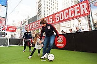 former women's national team player April Heinrichs plays a small sided game during the centennial celebration of U. S. Soccer at Times Square in New York, NY, on April 04, 2013.