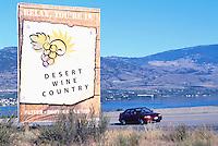 Highway Road Sign advertising Desert Wine Country, Osoyoos, South Okanagan Valley, BC, British Columbia, Canada