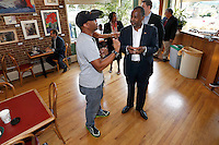 Republican presidential candidate Ben Carson right, speaks with Edwin Johnson at a Little Rock, Ark., coffee shop Thursday, Aug. 27, 2015. (AP Photo/Danny Johnston)