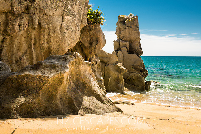 Pristine Anapai Bay on Abel Tasman Coast Track and its granite rock formations, Abel Tasman National Park, Nelson Region, South Island, New Zealand