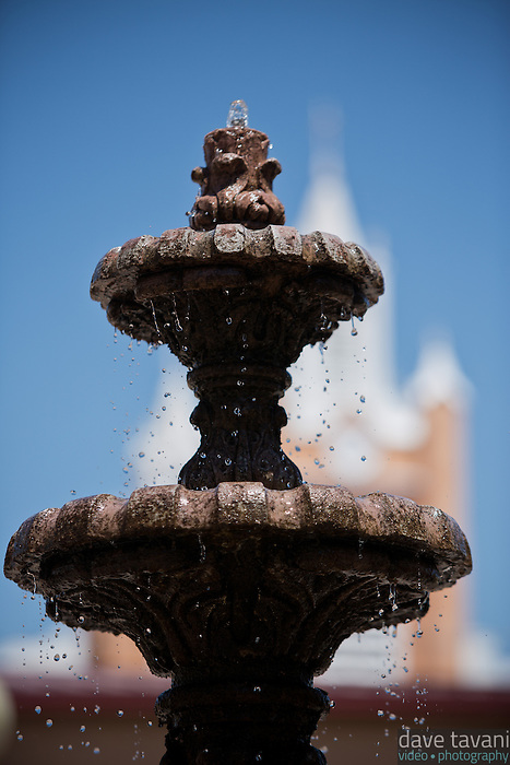 The fountain at Don Luis Plaza in Old Town Albuquerque sits across the street from San Felipe de Neri Church.