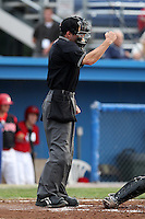 Home plate umpire Dan Merzel makes a call during a game between the Batavia Muckdogs and State College Spikes at Dwyer Stadium on July 7, 2011 in Batavia, New York.  Batavia defeated State College 16-3.  (Mike Janes/Four Seam Images)