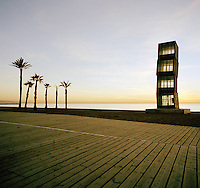 """The """"Homenatge a la Barceloneta"""" sculpture by German artist Rebecca Horn and palm trees by the beach in Barcelonas Ciutat Vella district ('District 1'), Spain"""