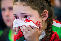 Dejected Wales fans at  the UEFA EURO 2016 fan zone set up in the Principality Stadium, Cardiff, Wales, Britain, 6 July 2016, watching Portugal vs Wales EURO 2016 semi-final match. Athena Picture Agency/ALED LLYWELYN/ATHENA PICTURES