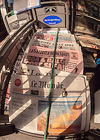 A collection of ethnic newspapers displayed at a newsstand in New York on Thursday, August 29, 2013. (© Richard B. Levine)