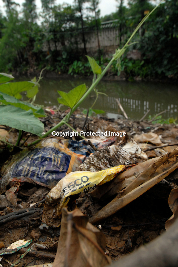 Rubbish from around the world including the United Kingdom's Tesco is recycled in Mai village, Shunde, China.  There is so much re-cycling in the area that the waste plastic spills out into streams and farmland polluting the environment.<br /> <br /> Photo by Richard Jones/ Sinopix