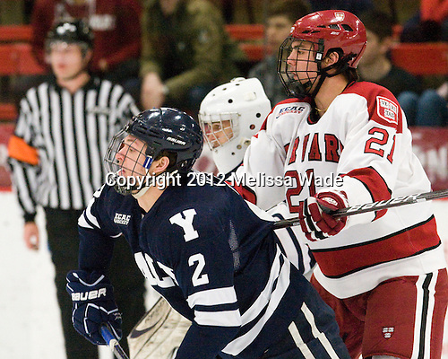 Gus Young (Yale - 2), Marshall Everson (Harvard - 21) - The Harvard University Crimson defeated the visiting Yale University Bulldogs 8-2 in the third game of their ECAC Quarterfinal matchup on Sunday, March 11, 2012, at Bright Hockey Center in Cambridge, Massachusetts.