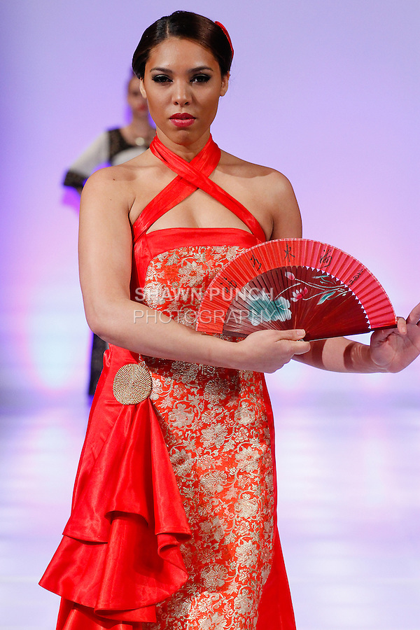Model walks runway in an outfit by YiLing Li, during Couture Fashion Week Fall 2014, on February 16, 2014.